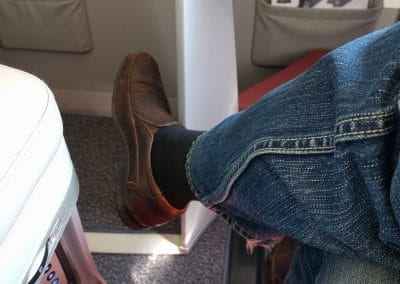 Legs crossed with footrest in the way