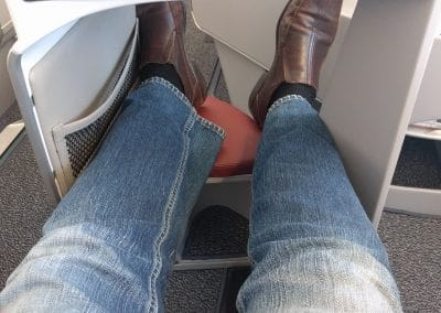 Legs hanging over into aisle